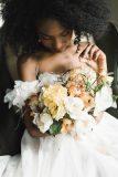 Bride in white dress holding floral arrangement bouquet | Nectar & Root Floral Designs Vermont Wedding Flowers